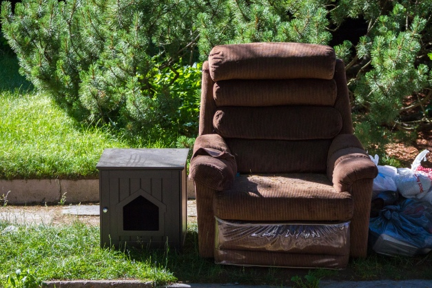 An armchair and pet house out on the curb for pickup. June 20, 2014.