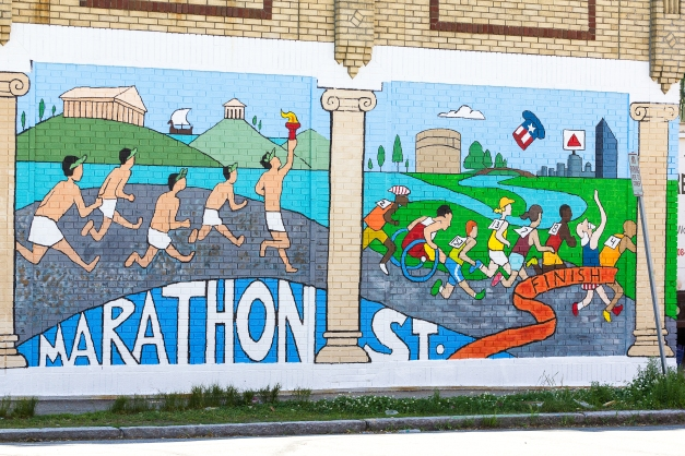 A newly created mural on the Marthon Street facing wall of Anthony's East Side Deli shows the transition of the marathon from ancient Greece to Boston. June 20, 2014.