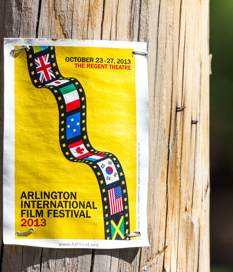 A flyer for the 2013 Arlington International Film Festival, stapled to a telephone pole along Massachusetts Avenue. June 20, 2014.
