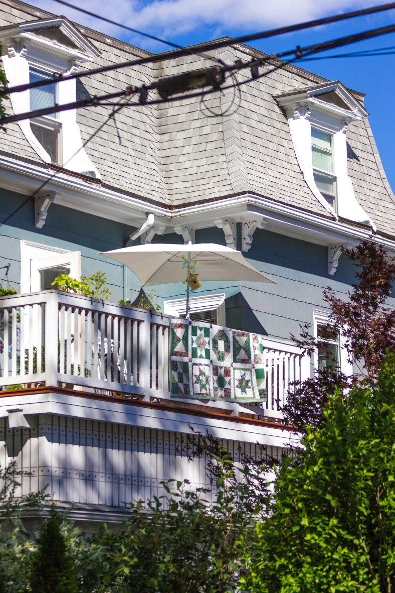 An airy second story porch on a Teel Street home. June 20, 2014.