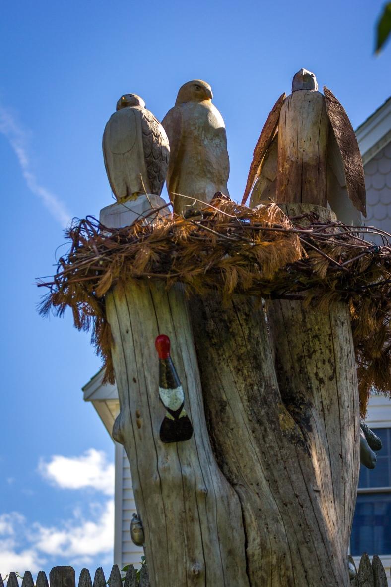 Wood sculptures on the stump of a fallen tree in Waldo Park. June 20, 2014.