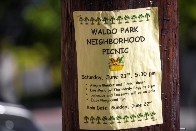 A flyer posted near Waldo Park in East Arlington informing the community about a first day of summer neighborhood picnic. June 20, 2014.