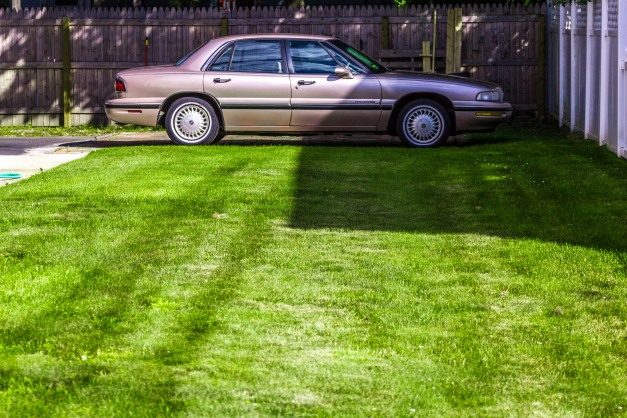 A Buick LeSabre parked at the far end of a Marathon Street lawn. June 20, 2014.