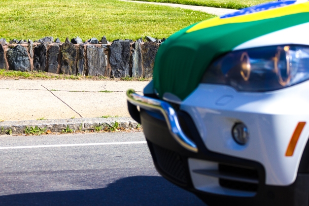 In celebration of the World Cup, a driver put a hood cover of the host nation Brazil's flag on their car—a sight very nearly captured by this photographer on Medford Street. June 20, 2014.