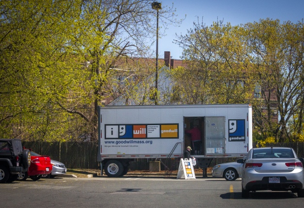 A man makes a donation to the Goodwill truck in the parking lot of Stop & Shop. April 26, 2013