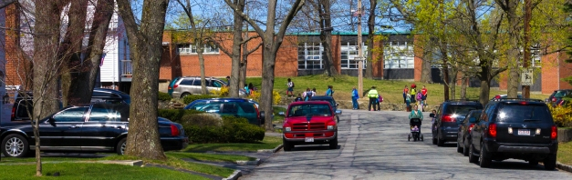 Parents and children at the Stratton School during after school pickup time. April 26, 2013.