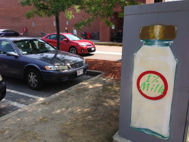 "A rendition of a bottle of milk on the side of a utility box that seems to have a ""cows and cow products"" theme. July 25, 2014."