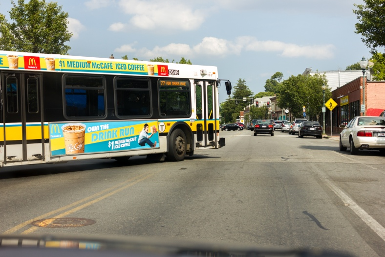 A 77 bus pulls out onto Massachusetts Avenue headed back to Harvard Station. July 7, 2014.