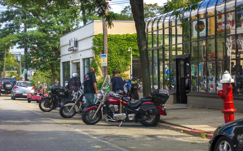 Bikers outside of Greater Boston Motorsports on Massachusetts Avenue. July 7, 2014.