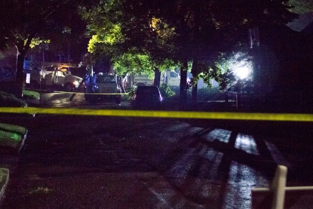 A crew works into the night on Pheasant Avenue to repair a telephone pole that came uprooted—heavy rain being the likely culprit. July 16, 2014