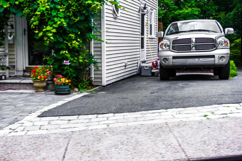 A pickup truck in the driveway of a Hemlock Street home. August 1, 2014.