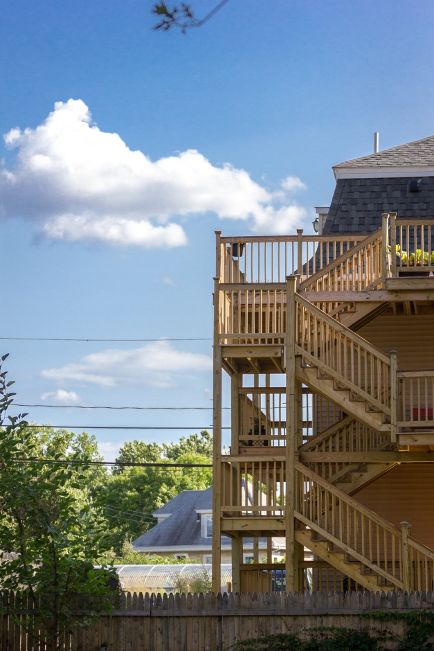 A recently built wooden deck on a two family home as seen from Mystic Valley Parkway. August 8, 2014.