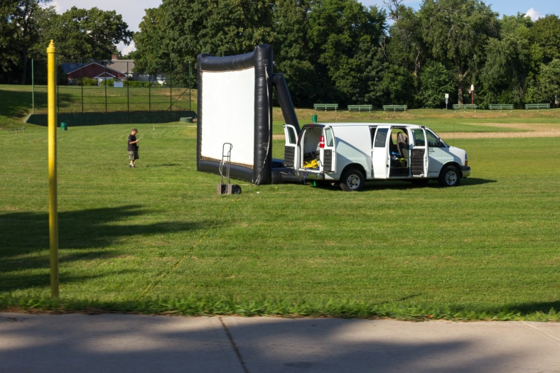 A crew sets up a movie screen at Robbins Farm Park for the Arlington Short Animation Film Festival. August 08, 2014.