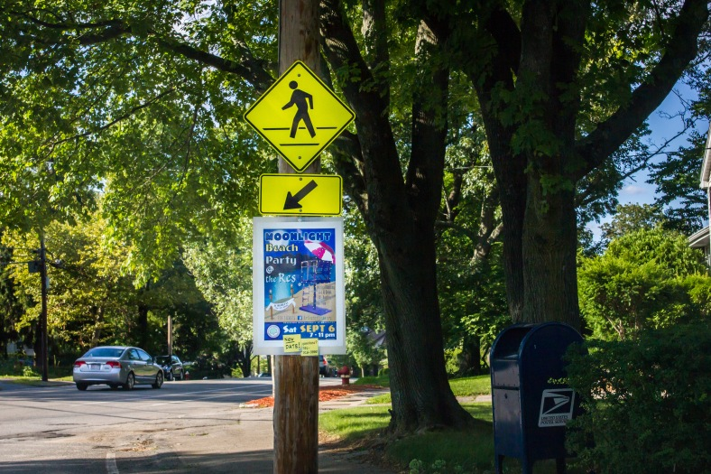 A sign along Park Avenue advertising the Moonlight Beach Party at the Arlington Reservoir. August 8, 2014.