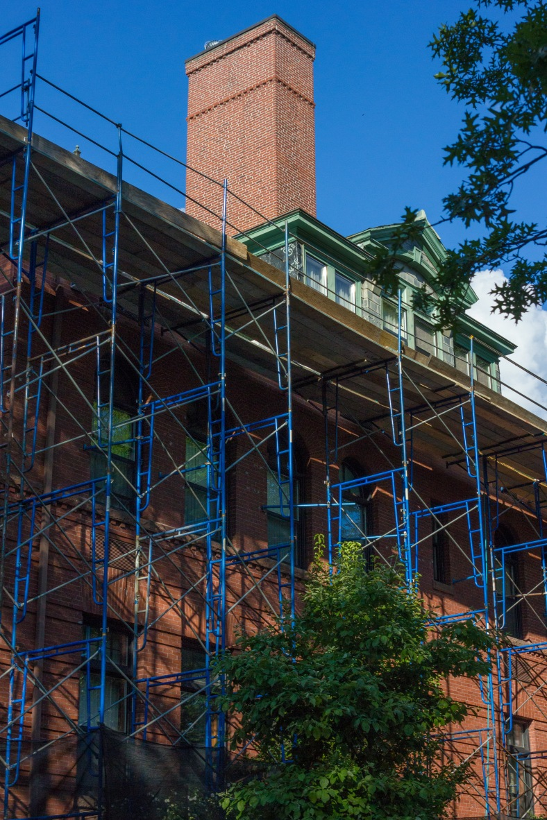 Scaffolding surrounds the The Locke apartments (formerly the Locke School,) as viewed from Paul Revere Road. August 8, 2014.