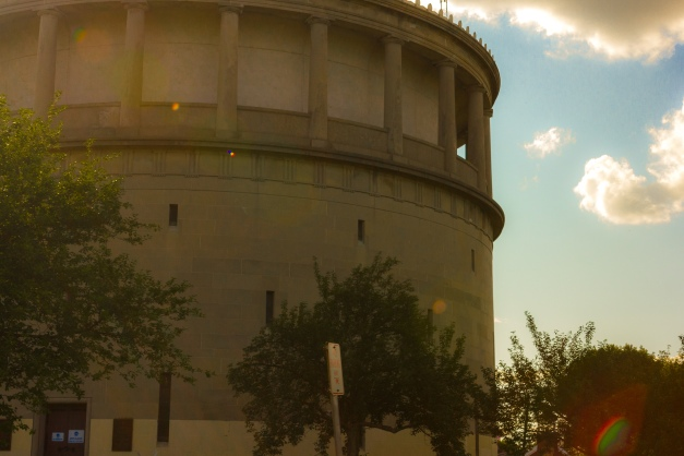 The sun shines bright over the top of the Park Ave water tower. August 8, 2014.