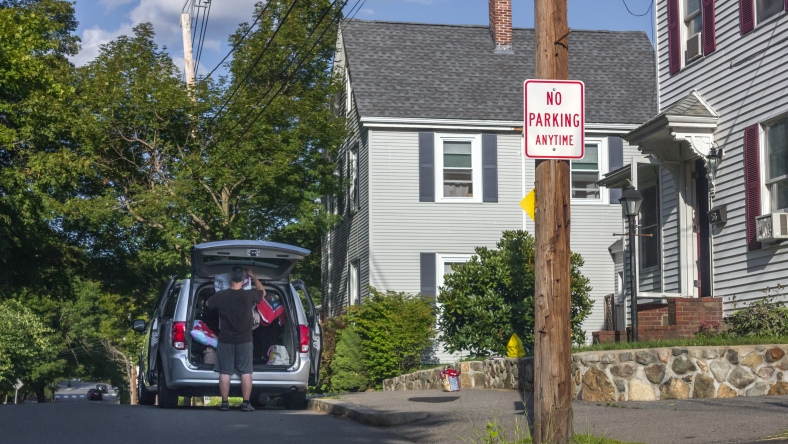 A man packs a van while parked at the crest of a hazardous blind hill on Brattle Street. August 8, 2014.