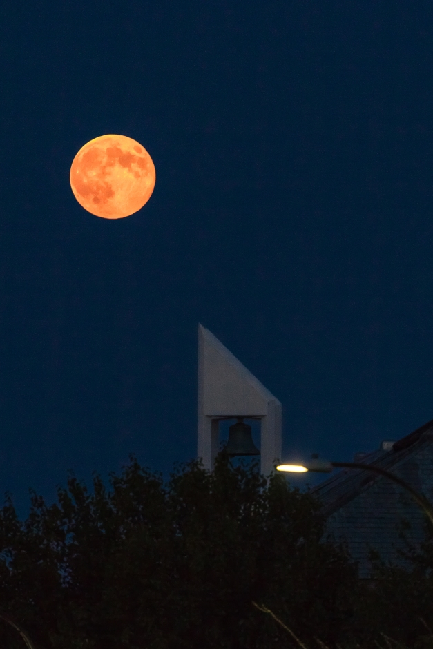 The chisel tipped bellower of the Unitarian Universalist Church in Arlington Center seems to point at the perigee full moon. August 10, 2014.