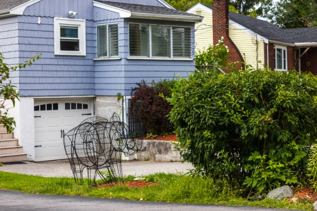 A wire frame elephant decorates the side lawn of a Dothan Street home. August 31, 2014. SC