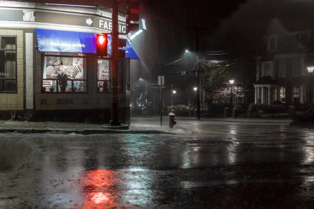 A heavy rain falls on a deserted corner of Massachusetts Avenue late on a Sunday night. August 31, 2014.