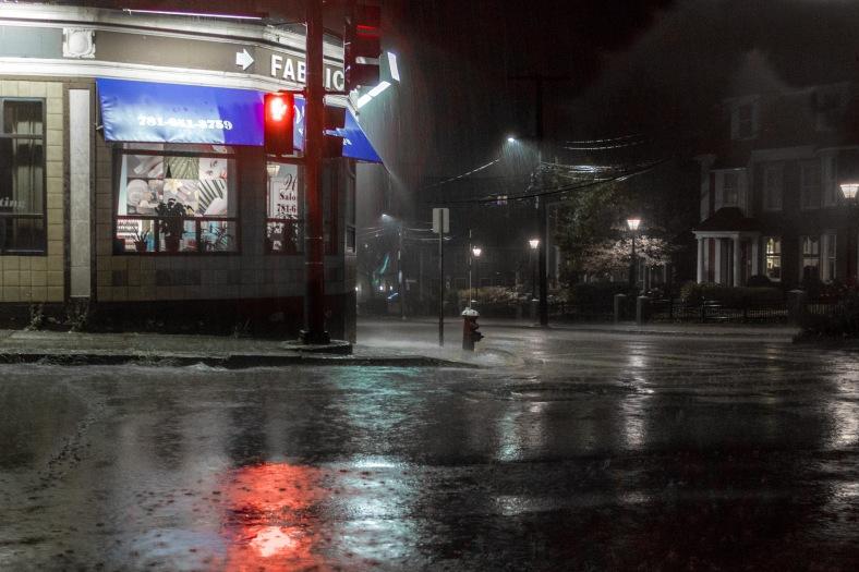 A heavy rain falls on a deserted corner of Massachusetts Avenue late on a Sunday night. August 31, 2014.