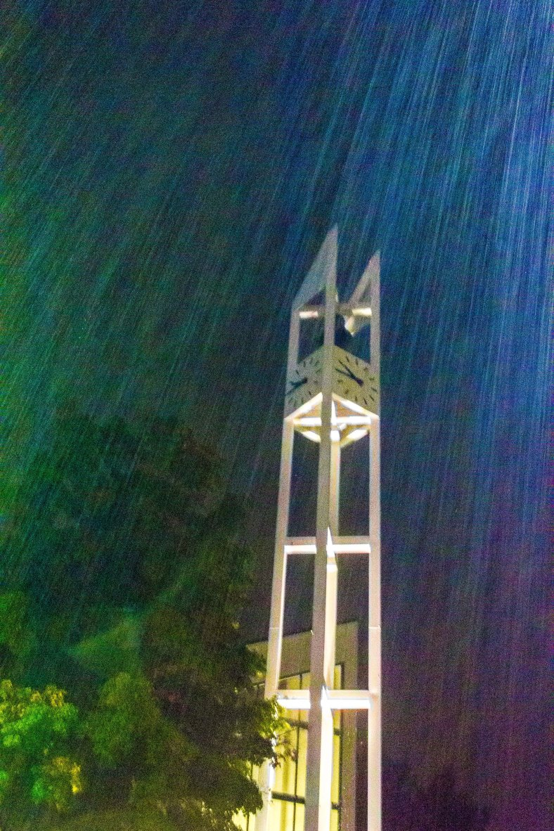 The clock tower of the Unitarian Universalist Church in Arlington Center in the heavy rain of a summer night. August 31, 2014.