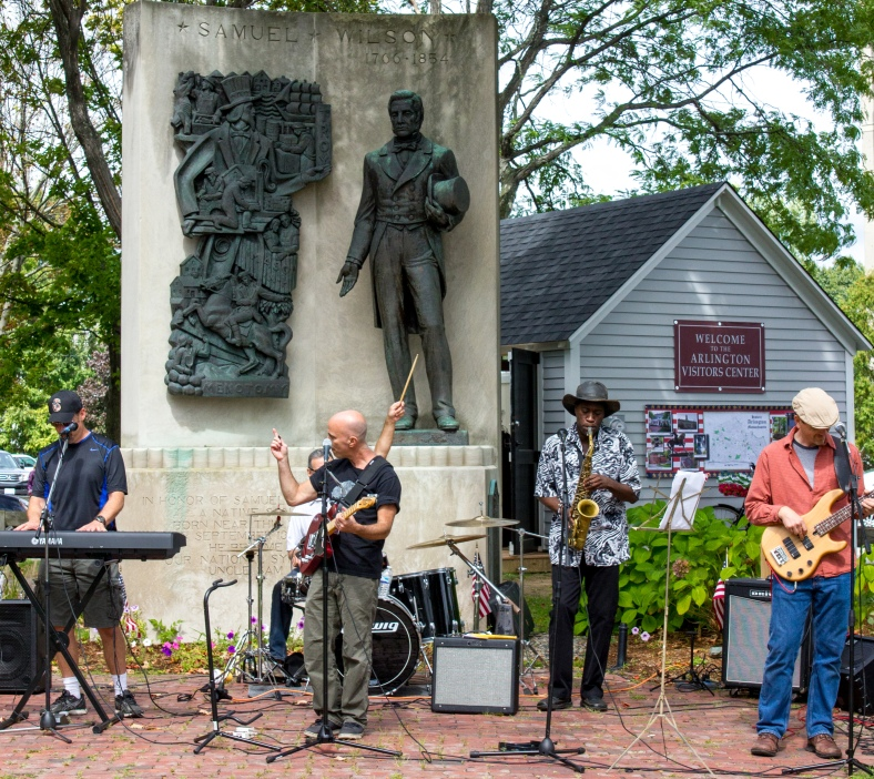 A band plays in front of the Samuel Wilson Statue at Uncle Sam Plaza during Arlington Town Day. September 13, 2014.