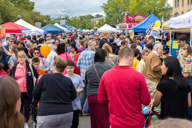 People pack Massachusetts Avenue for fun and food on Town Day. September 13, 2014.