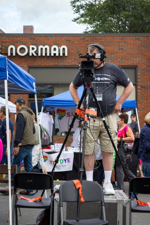 An ACMi cameraman capturing the main stage entertainment outside of Town Hall during Town Day. September 13, 2014.