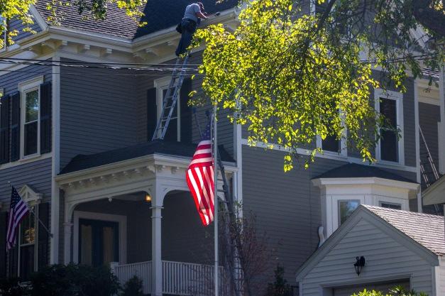 A man doing upkeep on his Park Avenue home. September 26, 2014.