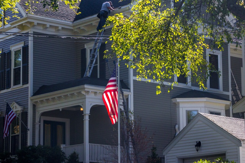 A man doing upkeep on his Park Avenue home. September 26, 2014.
