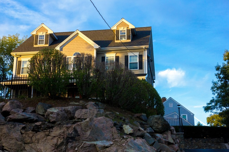 A house, constructed in 2003, atop a rocky ledge along Summer Street. October 10, 2014.