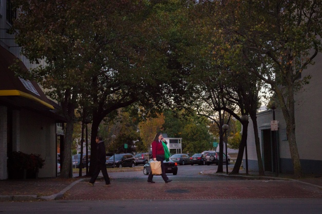 A woman crosses Lamson Way in Arlington Center. October 10, 2014.