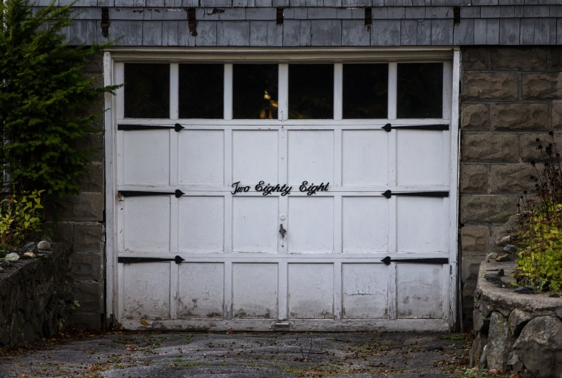 The house number on the garage door of a Washing Street home. October 17, 2014.