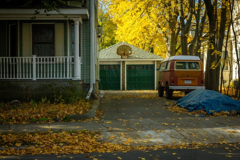 A high-clearance camper van, customized for the occasional off-road experience, in the driveway of a Broadway residence. November 10, 2014.