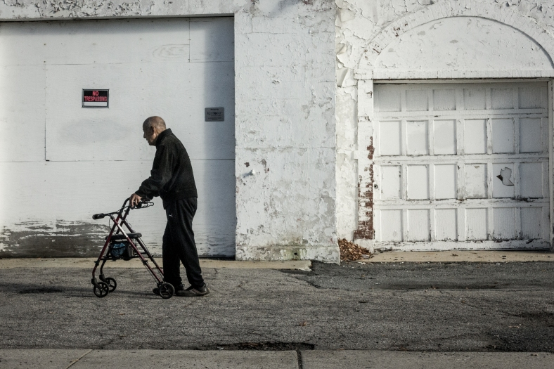 A man makes his way towards the Stop and Shop past an empty property on Massachusetts Avenue. November 10, 2014.