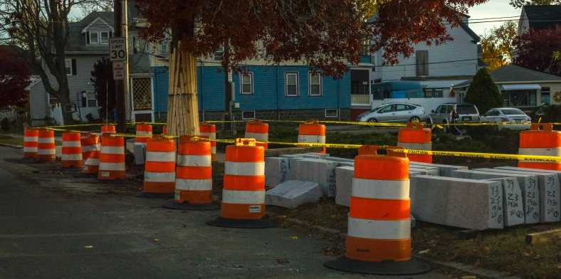 Orange barrels surround a supply of curbstones awaiting placement as part of the Mass Ave project in East Arlington. November 10, 2014.