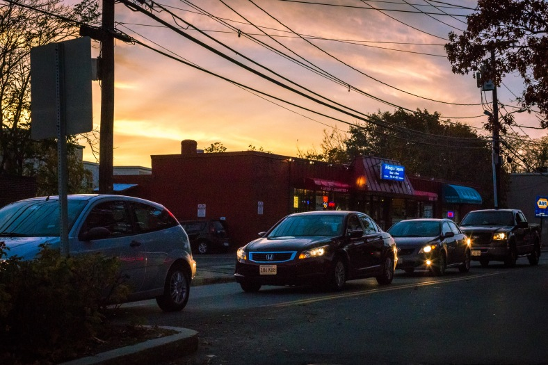 Vehicles pile up at the Summer Street and Mill Street traffic light under a brilliant twilight sky. November 10, 2014.