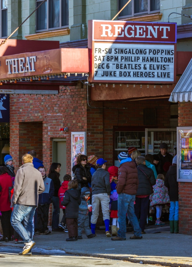 Parents and children wait to be let in to a sing-a-long screening of Mary Poppins at the Regent Theatre. November 29, 2014.