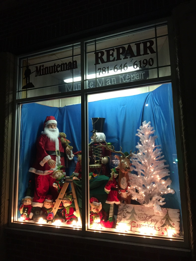 A festive Christmas display in the oft changed front window of the Minuteman Repair shop in East Arlington. December 17, 2014.