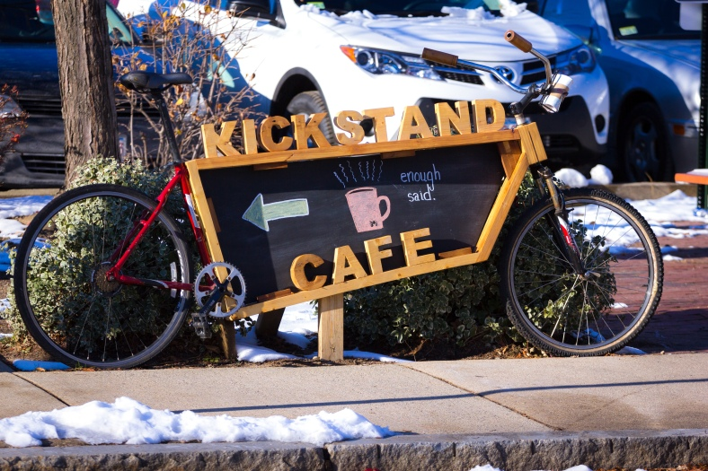 A sign directing bikers coming from Cambridge on the Minuteman Bikeway to an Arlington Center hotspot. November 29, 2014.