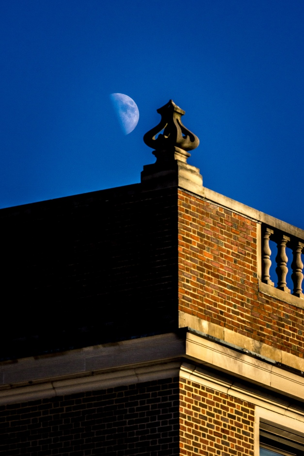 A waxing half moon seen next to an architectural ornament on the St. Agnes school in Arlington Center. November 29, 2014.