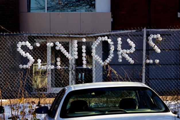 Arlington Catholic seniors left their mark on the fence behind the high school in Arlington Center. November 29, 2014.