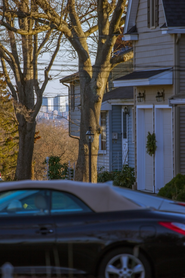 The buildings of Boston can be seen in the distance in this view down Epping Street. December 26, 2014.
