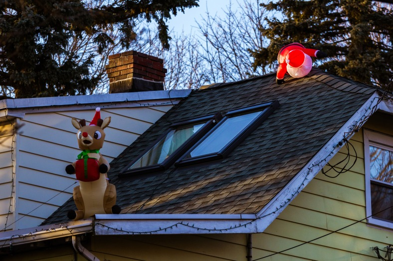 Possibly rushing due to lateness caused Santa to trip on the roof of a Washington Street home. December 26, 2014.