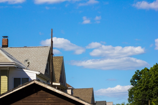 Blue sky and a few clouds over the rooftops of East Arlington.  June 20, 2014.