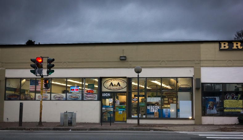 The A&A Delicatessen on Massachusetts Avenue under a threatening winter sky. January 03, 2015.