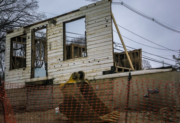 A home on Eastern Ave in the late stages of demolition.  January 03, 2015.