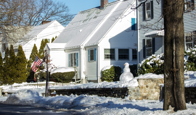 A snowperson in the front yard of a Cutter Hill Road home. January 25, 2015