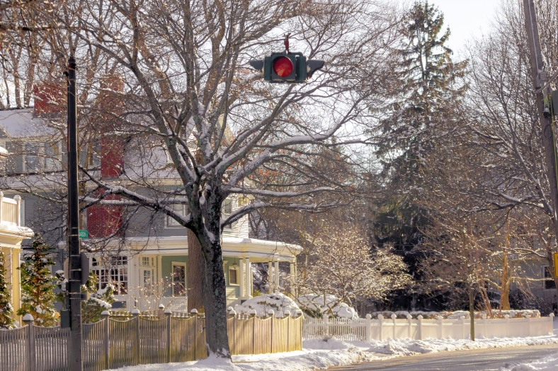 A light signaling a four way stop hangs over the intersection of Jason Street and Gray Street. January 25, 2015.